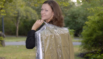 woman carrying dry cleaning